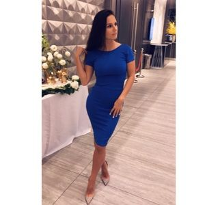 Blue, mid length, tight fitting dress